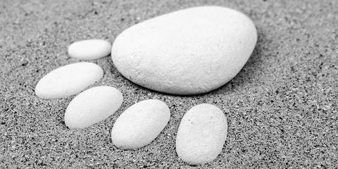Standort - Fuss aus Steinen